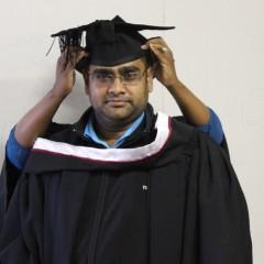 Avinash Nandkoomar receives his hood