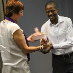 27-Ntokozo Dhlamini receives his gift from Greta Bosiers